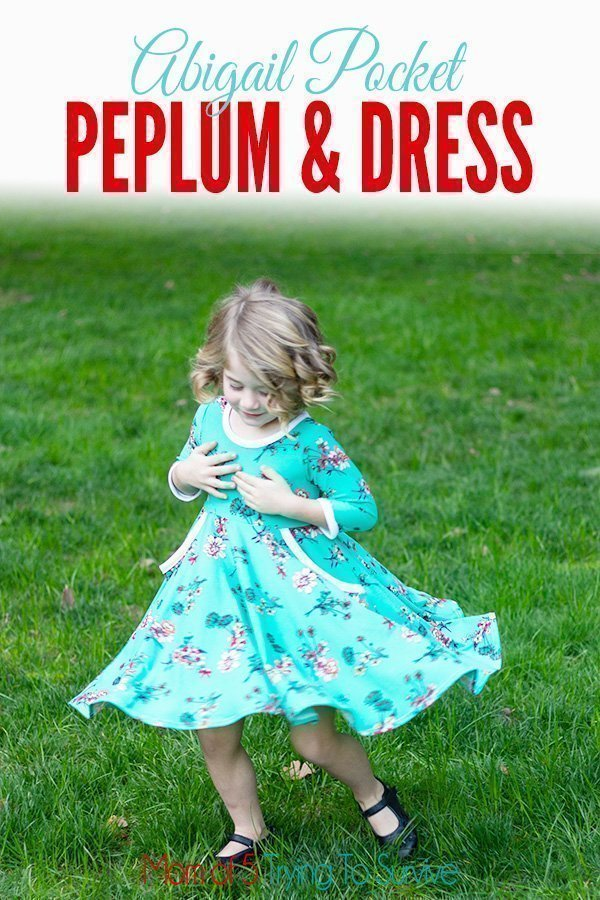 Little girl twirling in dress. This dress was made using the Abigail pocket peplum and dress pattern from Simple Life Pattern Company