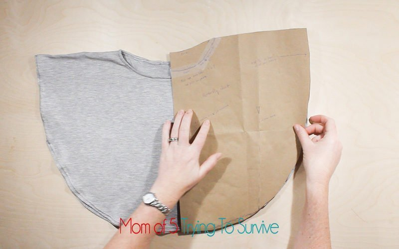 line up the paper pattern with the shirt