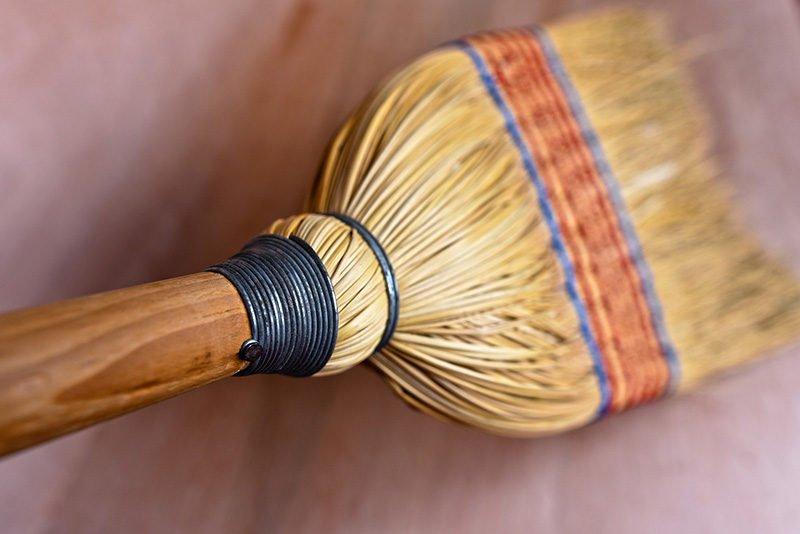 broom sweeping the floor