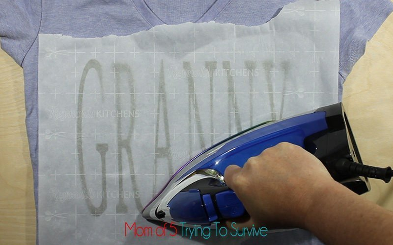 after peeling carrier sheet off, iron with parchement