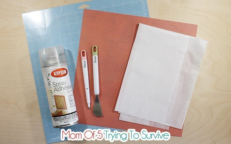 supplies needed for the 4th of july paper lantern. Cricut machine, paper, tissue paper, adhesive spray, scoring stylus, spatula tool, tape