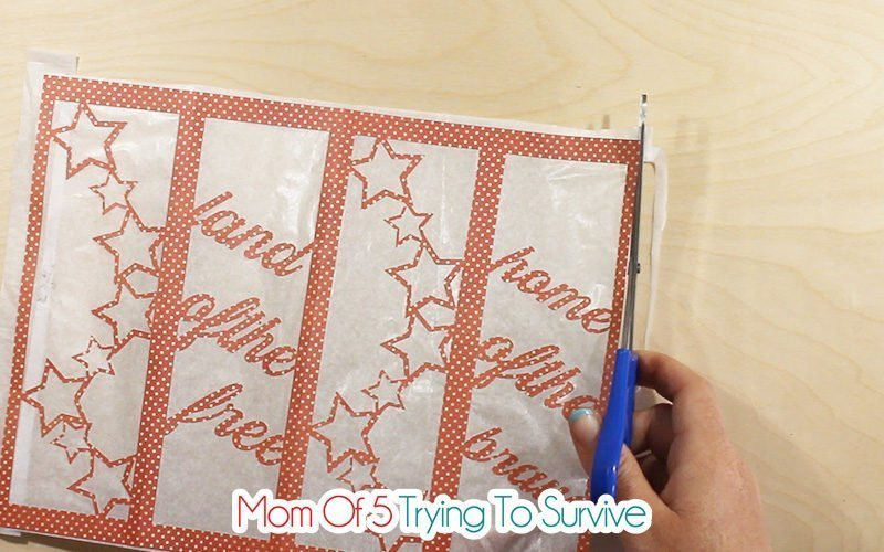 trim the excess tissue paper from around the paper lantern