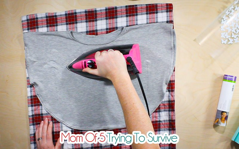 before placing heat transfer vinyl on shirt, pre-heat the surface