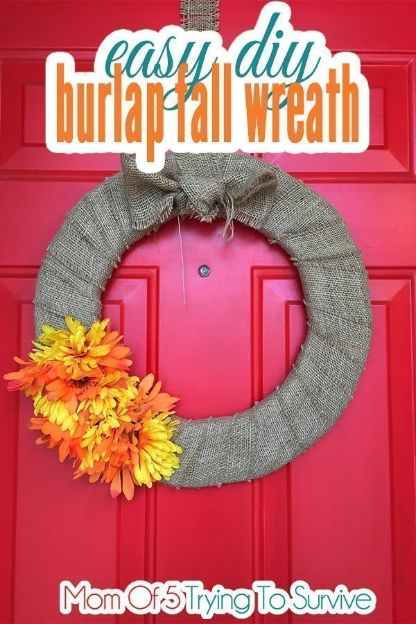 finished burlap fall wreath hanging on door