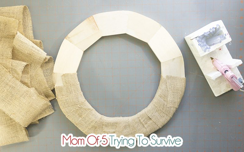 wrap burlap around the wreath form